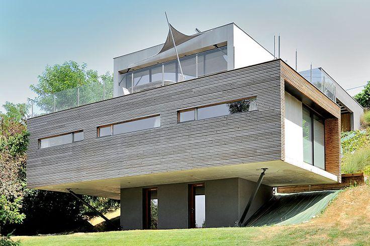 Maison en deux blocs : béton et bois