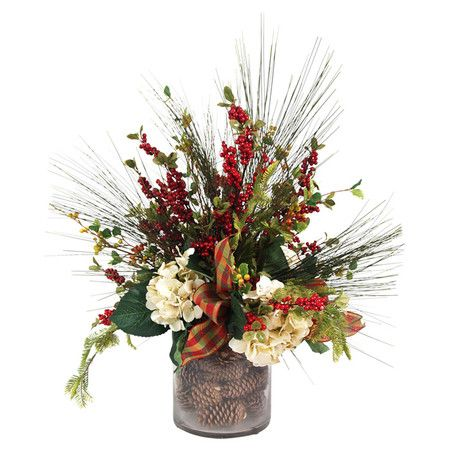 Silk hydrangeas, berries, and cedar arranged in a faux pinecone-filled glass vase.  Product: Faux floral arrangement...