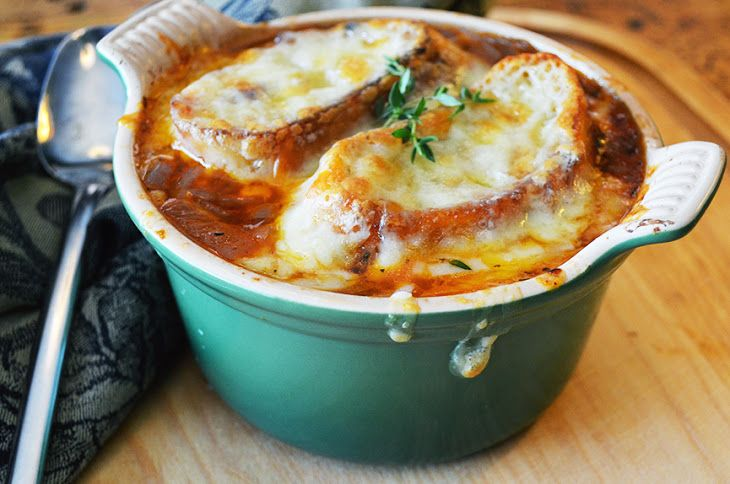 The Best French Onion Soup Recipe Soups with extra-virgin olive oil, onions, leeks, sliced shallots, kosher salt, garlic cloves, tomato paste, herbes de provence, bay leaf, dry red wine, sherry vinegar, beef stock, freshly ground pepper, unsalted butter, baguette, gruyere cheese, thyme