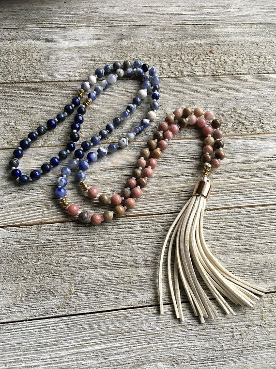 Beautifully Hand Knotted using waxed linen thread. I added a (fake) suede light beige tassel. Rhodonite properties: Rhodonite is a stone of compassion, an emotional balancer that clears away emotional wounds and scars from the past, and that nurtures love. It stimulates, clears and