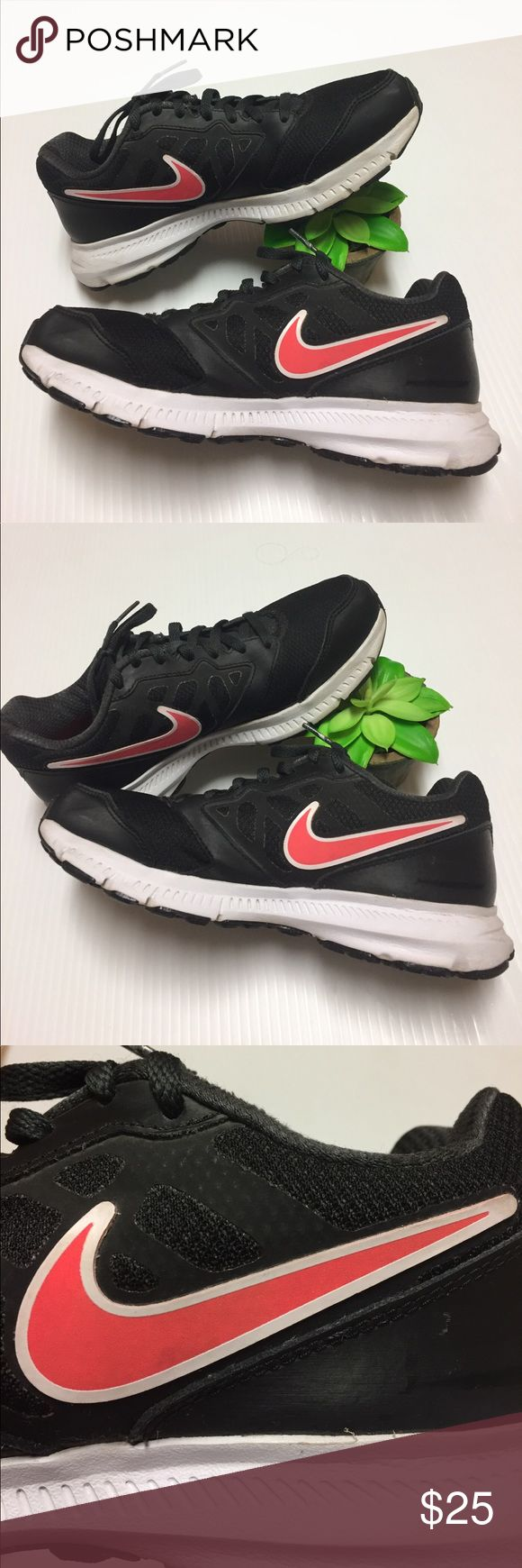 Women Nikes Black Nikes with coral pink signature Nike logo, good preowned condition with a few tiny scuffs and an average amount of light wear as shown Nike Shoes Sneakers