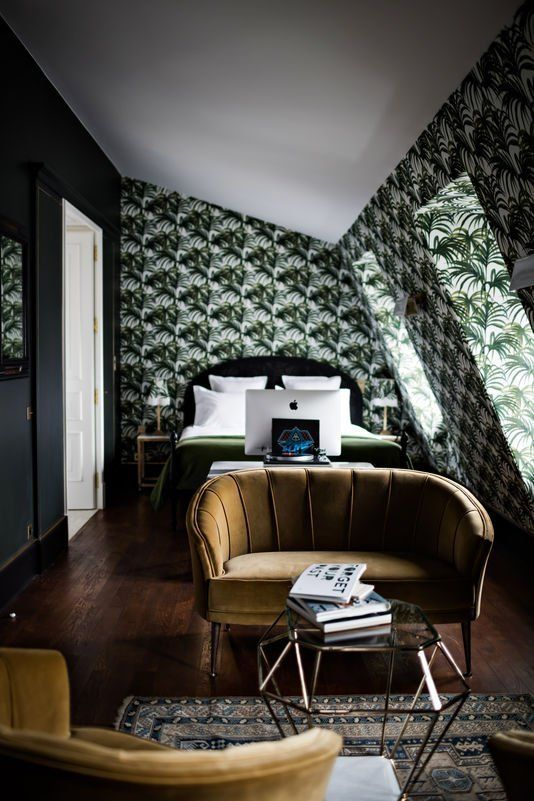 The Hotel Providence rocks a really boldly patterned wallpaper — and wisely keeps everything else in the space relatively simple (and in the same color palette).