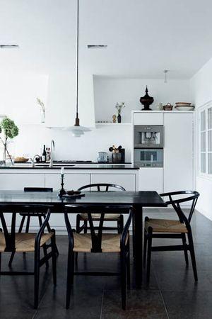 dark floor, white white kitchen with black counters.....