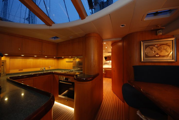 Dibley designed Commander 66 Cruising Yacht. Galley and Dining just forward of raised Saloon.