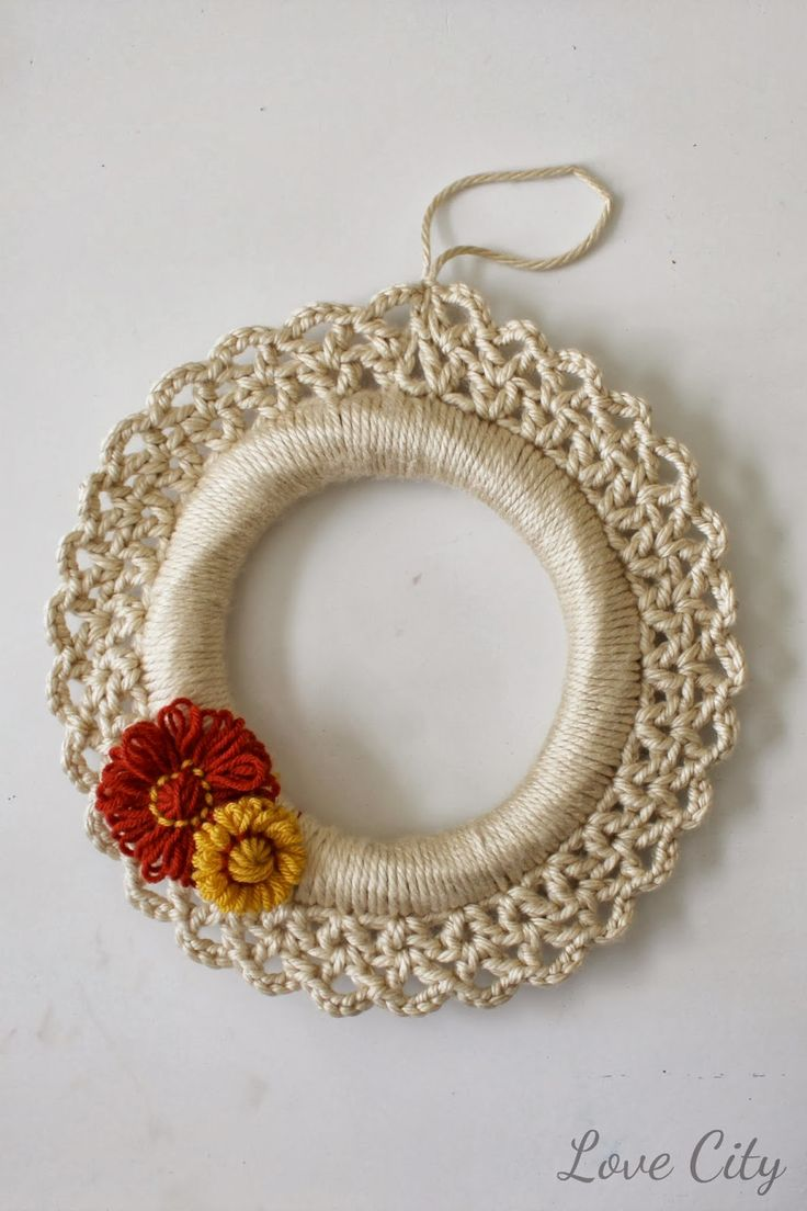 To make the wreath, I started by working single crochet stitches around the wreath form. I made sure to keep them close together and counted them so I had a multiple of 3 for my next round. For round 2, I worked a v-stitch all the way around. For round 3, I also worked a v-stitch with 4 chains in between the double crochets rather than just one. This left a sweet little scalloped edge. When finishing off, I made sure to create a loop for hanging the wreath