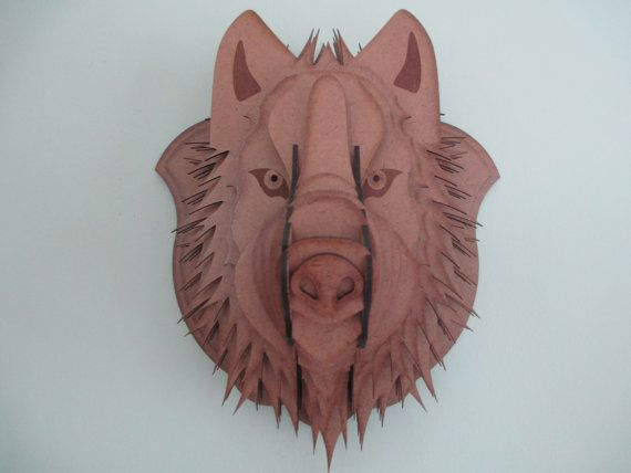 This Big Bad Wolf Trophy is cut from 1/8 inch hardboard. It measures approximately 13W x 15H x 11D. The Wolf is shipped assembled and is easy to hang requiring just a nail in the wall.  Design © 2014 Heads On A Wall