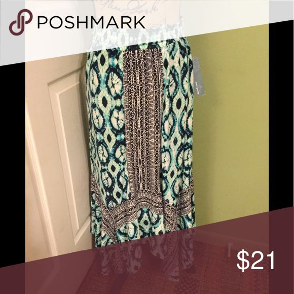 Navy/Turquoise Shark Tail Maxi Skirt This delightful maxi skirt has a Shark Tail hem. The picture shows the stripe to be black, it is actually navy blue. Casual blend fabric for comfort. Bundle it with one of my matching tanks. Passports Skirts Maxi