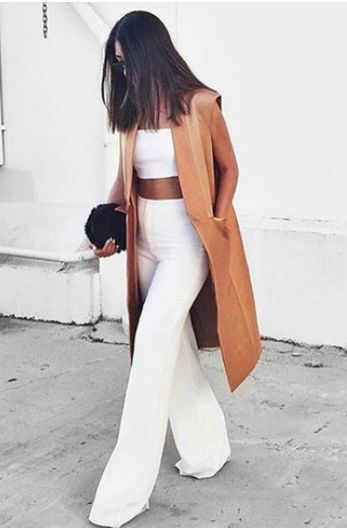 Women's fashion   White crop top with high waisted flared pants and long cream vest