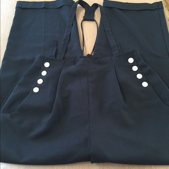 Navy Pin Up Pants Semi jumpsuit style - cuffed pants pleated with button suspender straps - Dark Navy with white buttons front and back.  Very cute!  Has been worn so not perfect but still in great condition - size 16 - non smoker Europa Pants