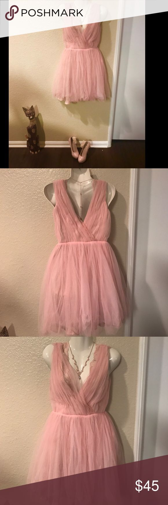 Zara blush/pink tulle sleeveless lace dress. Zara size small. Has zipper on side. Blush pink tulle dress with lace on the top. Think Carrie Bradshaw. Bought and wore once. Probably needs to be ironed but other than that it's in good conditioned. Sale is for dress only. Zara Dresses Midi