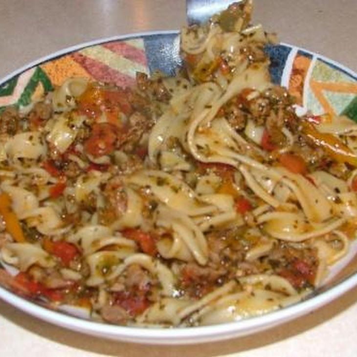 Italian Drunken Noodles Recipe Main Dishes with italian sausage, salt, italian seasoning, black pepper, red pepper, yellow peppers, orange bell pepper, garlic, white wine, diced tomatoes in juice, parsley, basil, egg noodles