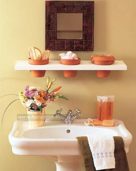 Small Bathroom Storage. Such a cute idea with the flower pots. :)