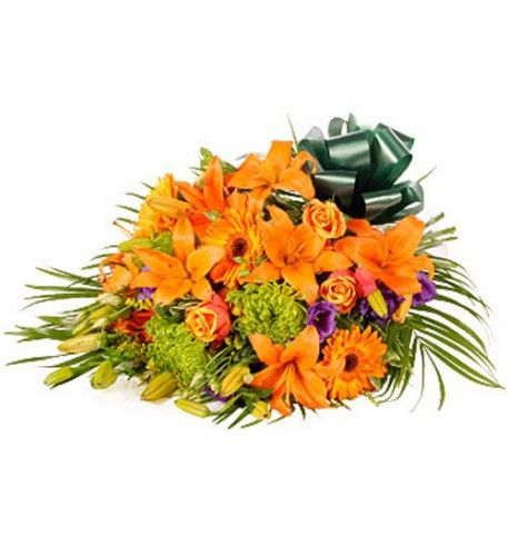 Sunning orange lilies, orange roses and orange gerberas complemented with blue lisianthus this a sensual contemporary floral tribute.