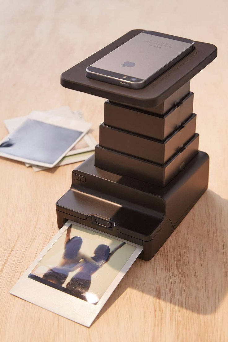 Impossible Instant Lab Universal Photo Printer $169 this is pretty kick ass. Any photos on your phone instant polaroid prints and they aren't the mini ones either, full sized prints!
