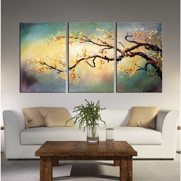 Show off your artistic side with this Hand-painted 'Yellow Plum blossom' 3-piece Gallery-wrapped Canvas Art It is hand painted and can be hung horizontally. This piece of art will surely add a splash