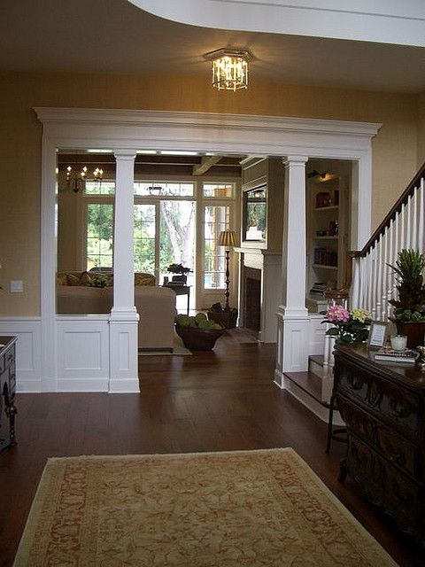 Entry-way to die for!  Columns, big dresser/table, skylight, beautiful living room