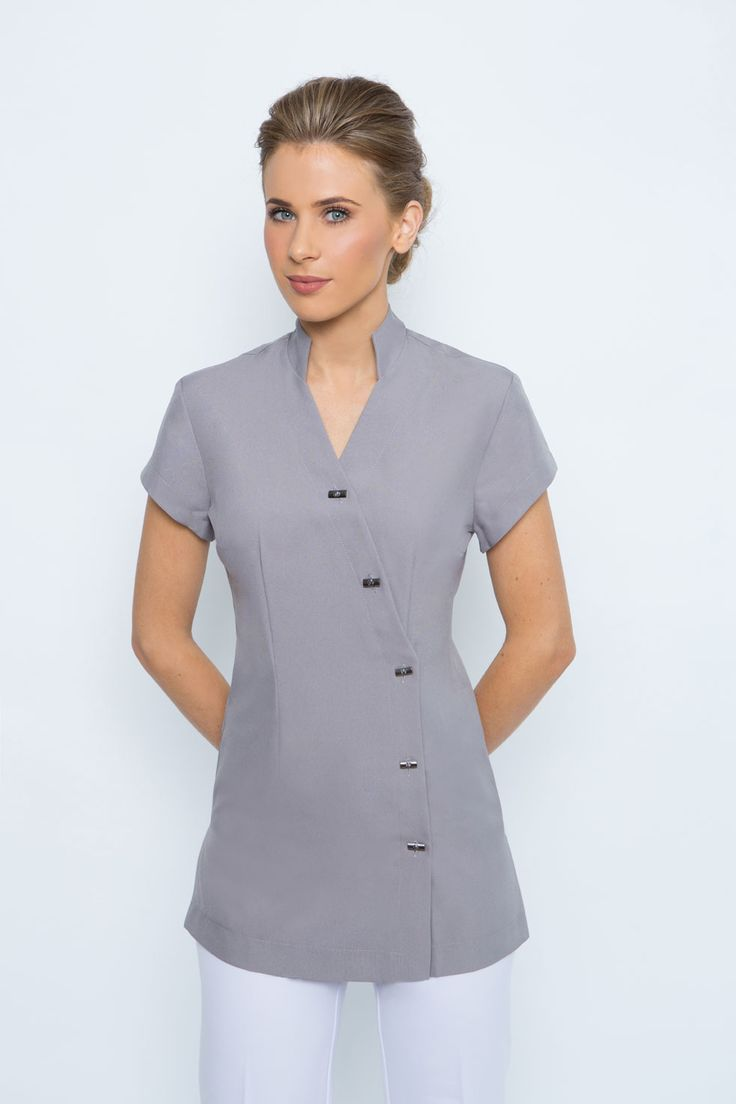 SPA 05 tunic - Dove grey. Professional, comfortable, stylish. Tunic with button front detail, mandarin collar & cap sleeves. Available in black, white, electric blue, dove grey , charcoal grey (taupe & navy only made to order ) Easy wash and wear corporate grade fabric. Standard Australian sizing 6-24, refer to our sizing chart. The buttons on this tunic can be moved from left to right to make the tunic bigger or smaller if needed.