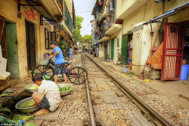 Knowing the timetable: When the track is clear after a train has passed, local residents m...
