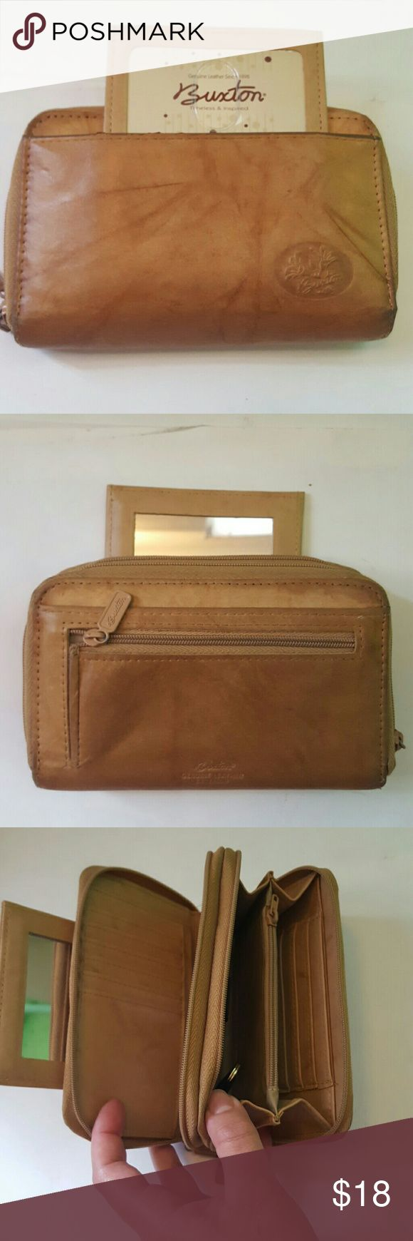 *Sale* Buxton wallet Condition 8/10,small scuffs on the bag, barely noticeable, it has many pockets, pen holder, key holder, mirror, genuine leather exterior, Height 4', Length 6', Width 1.5', if you want to request more pictures, don't hesitate to ask me. Thanks for your time. Buxton Bags Wallets