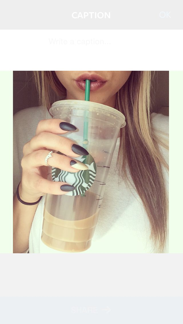 Bold Mary Kay raisinberry lips with black and gold matte almond shaped nails, crown midi ring, and a Starbucks iced caramel macchiato