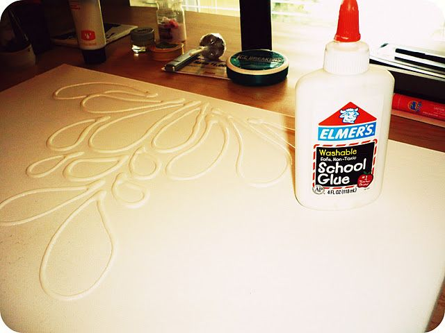 Love this - use Elmer's glue to make drawings on canvas' and then spray paint. Bold, simple, and beautiful decor!