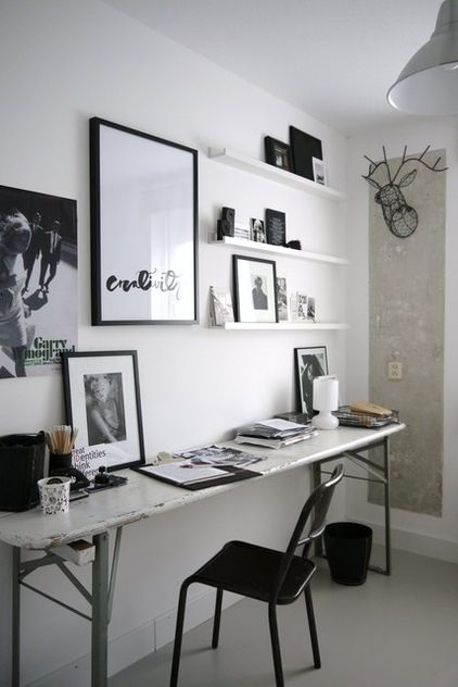Nordic style loves black and white, and often includes creative vignettes of posters and photography. Picture ledges are the perfect starting point for a gallery-style wall. Eclectic home office by Vosgesparis