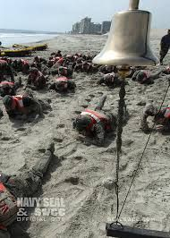 """BUDS trainees low crawl on the beach below the infamous """"bell"""" for more Navy SEAL workouts go to:  http://sealgrinderpt.com/navy-seal-workout/navy-seal-workout.html/"""