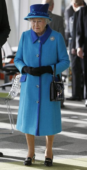 Queen Elizabeth II visits the new headquarters of the Co-operative group on November 14, 2013 in Manchester, England.