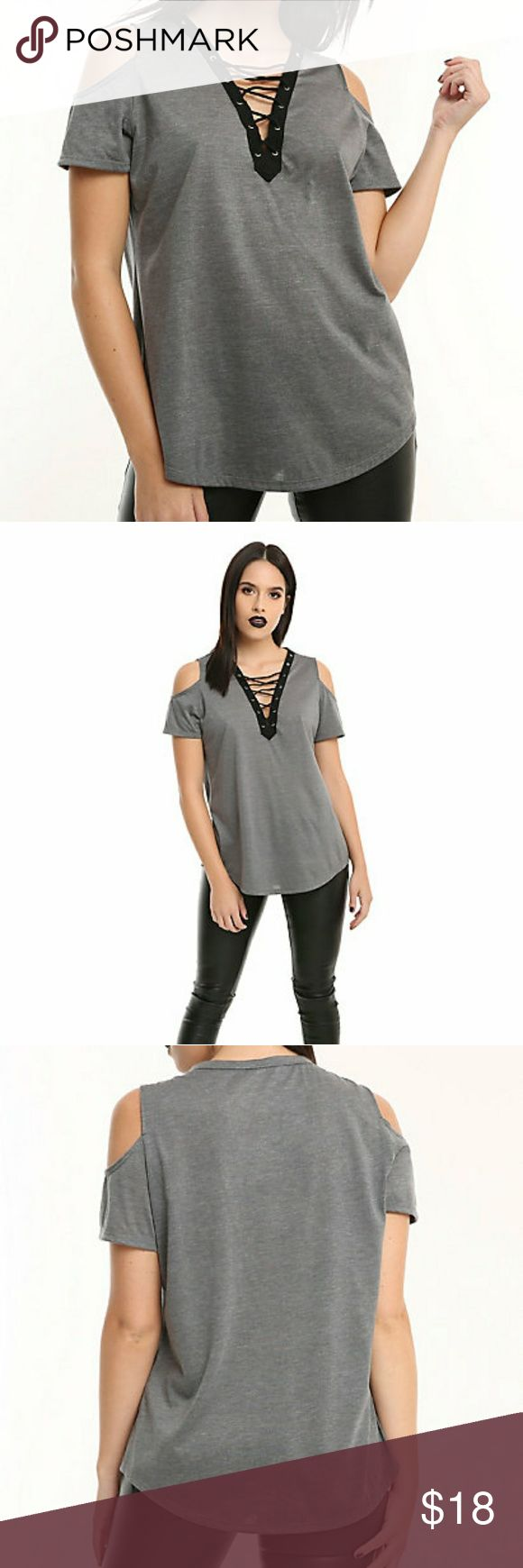 Grey Lace-Up Girls Cold Shoulder Top Show some skin! And by skin we mean your shoulders. This grey top features a cold shoulder design, black trim neckline with silver tone grommets and lace-up detailing.      60% cotton; 40% polyester     Wash cold; dry flat     Imported Hot Topic Tops