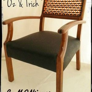 Oz & Trich are a stunning set of 2 old Imbuia Occasional Rattan back chairs that have been mercilessly subjected to the Mantiques treatment. For starters we stripped off the years of grime and ripped out the old rattan backs replacing them ...with orange and black ribbing, the seats have been completely rebuilt for comfort and recovered in Black Ostrich Skin leather touch and finished off with black highlights down the center of the armrests.