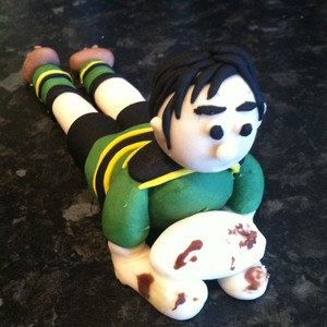 Rugby player around 3 and a half inches in length, Can be made with other rugby colours.