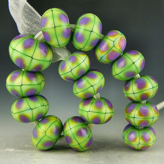 a set of 15 graduated green and purple plaid lampwork beads on etsy