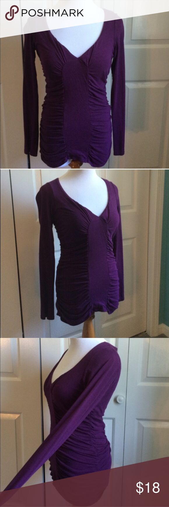Plum Ruched Top Dark purple long sleeve top with ruching down sides and front. Excellent for hiding a belly/pouch. Built in bra underneath. Excellent condition. Victoria's Secret Tops Tees - Long Sleeve