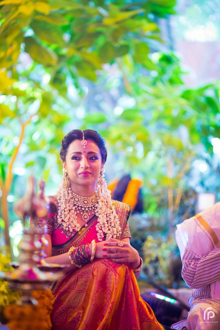 South Indian bride. Trisha Krishnan engagement.Neeta Lulla silk sari. Jasmine flowers. Tamil bride. Telugu bride. Malayalee bride. Hindu bride.