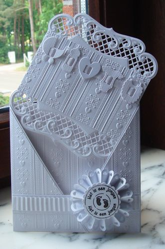I thought this was a new Marianne Designs die but after analyzing the layering of this card, I found that is the large Oval die (which I already have!) which was cut into 2 pieces and made into top and bottom edges. How clever! Stunning!