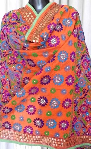 This beautiful phulkari dupatta on handloom chanderi fabric has been hand embroidered with wool thread and sequins. A graceful and stunning accessory for your evenings - See more at: http://giftpiper.com/HandembroideredChanderiPhulkariDupattaDarkOrange-id-582269.html#sthash.oqZ8m09n.dpuf LOVELY!!!