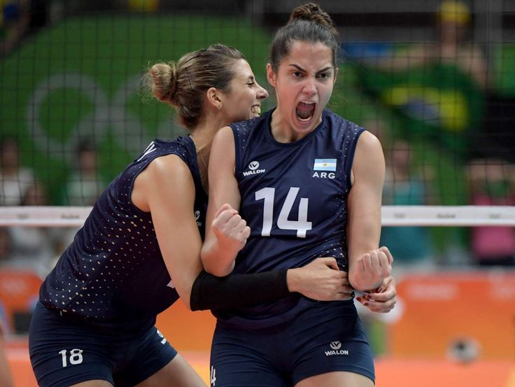 Volleyball:    Argentina setter Yael Castiglione (18) and wing spiker Josefina Fernandez (14) celebrate a point during a volleyball match.