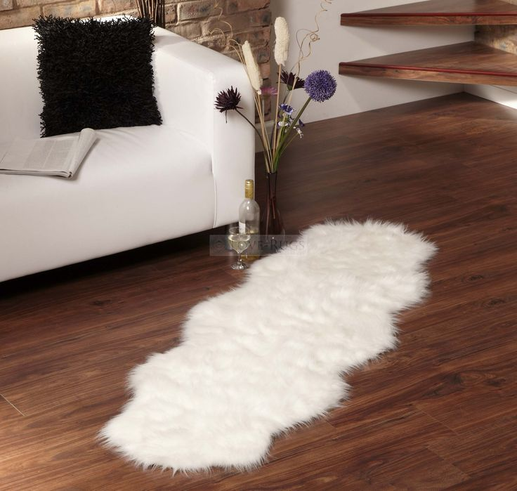 white acrylic faux sheepskin rug plus pretty sofa and corner shelve for living room decoration ideas