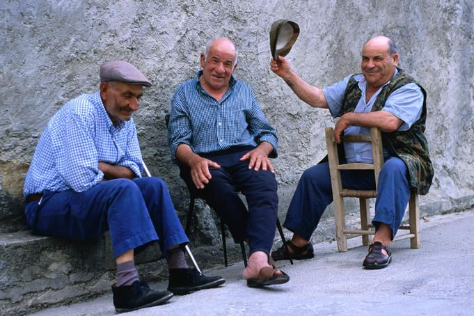 Tuili, Sardinia    Elderly Sardinian men chatting in the village of Tuili.