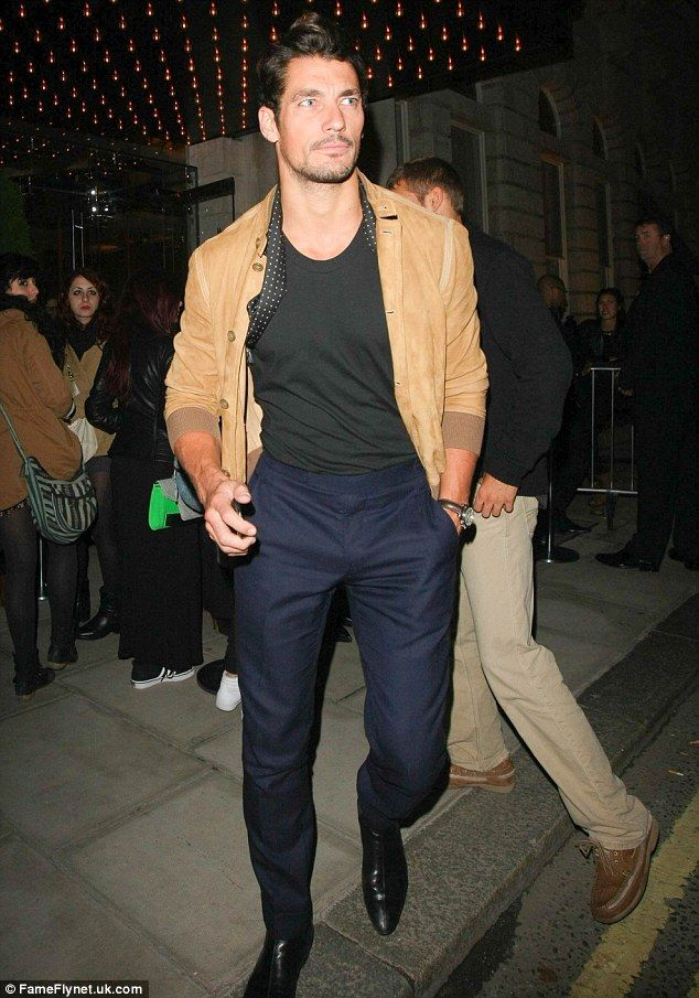 David Gandy wearing navy high-waisted trousers, a simple black tee and a camel jacket Sept. 2013