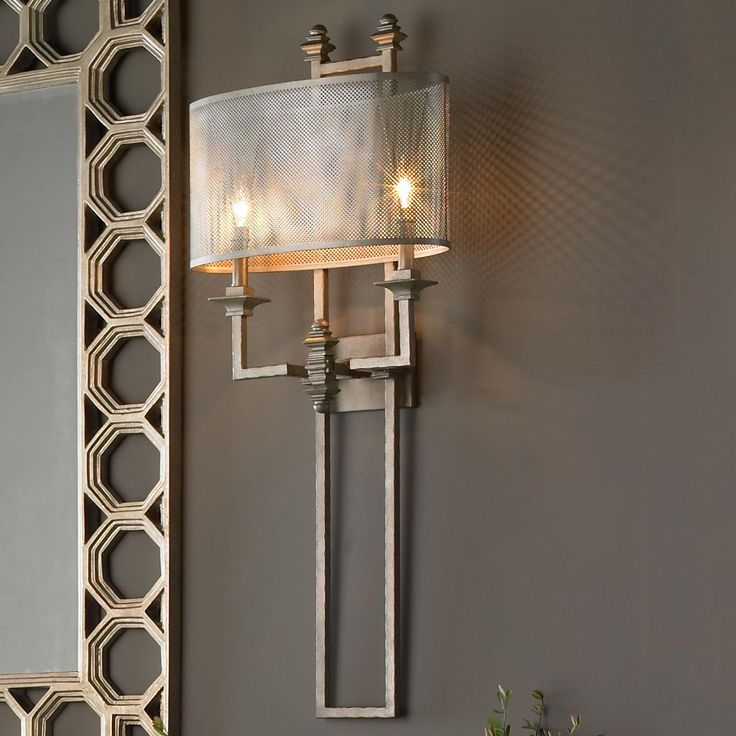 Mesh Screen Metal Sconce The metal mesh shade and aged silver finish create a bold look with an edgy architectural allure. Blended styles of industrial, modern and transitional are evident in this over scaled wall sconce
