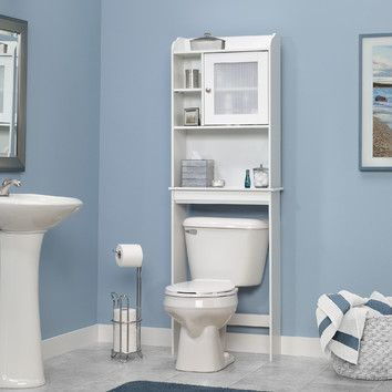 Features:  -Caraway collection.  -Space-saving cabinet fits over toilet.  -Adjustable shelf behind frame and panel door with reeded translucent insert.  -Cubbyhole storage with adjustable shelf.  -Bea