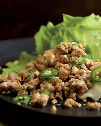 Thai Ground Pork Salad- an addictive appetizer of ground meat spiked with chiles, lime juice and fish sauce and served with lettuce leaves for wrapping.