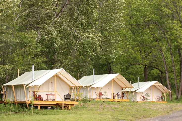 Glamping tents lined up at River Dance Lodge