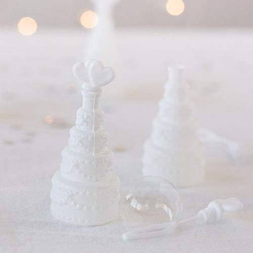 Mini wedding cake bubbles are a classic looking and fun way to celebrate the newlywed Mr. and Mrs.