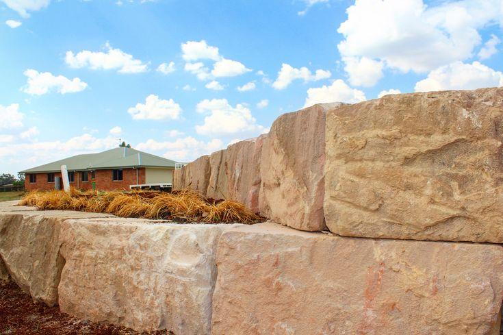 Sandstone Log. Sandstone retaining wall. Sandstone blocks.