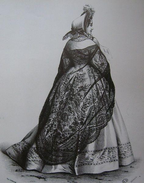Ese vestido repetidamente por los visitantes extranjeros consistía en una mantilla , falda de bayeta