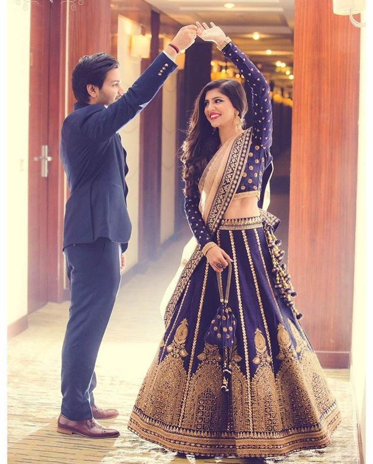 Pretty Lehenga - love the deep navy blue with long sleeves - thinking it would be great for a fall or winter Indian wedding