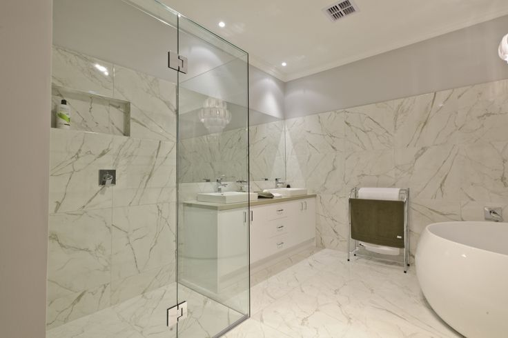 The Range - Custom Designed by Busby Homes. Designer ensuite with double vanity, feature spa bath and large frameless shower.