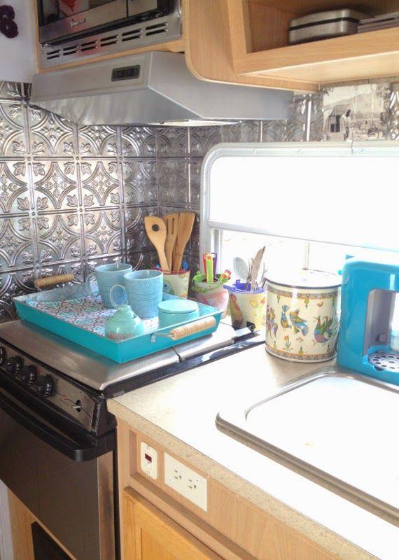 rv kitchen remodel travel trailer camper turned glamper renovation faux tin panel backsplash. Black Bedroom Furniture Sets. Home Design Ideas